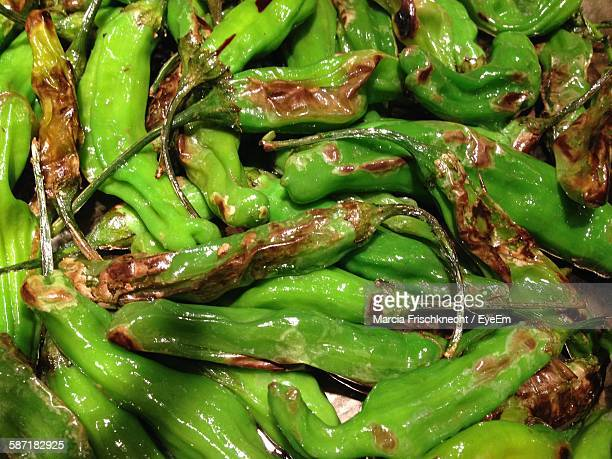high angle view of roasted chilies - green chili pepper stock pictures, royalty-free photos & images