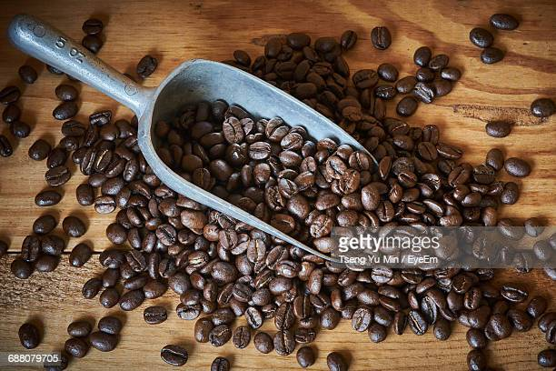 High Angle View Of Roasted Coffee Bean Spilled From Spoon