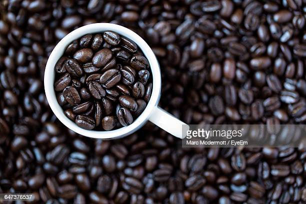 High Angle View Of Roasted Coffee Beans In Cup