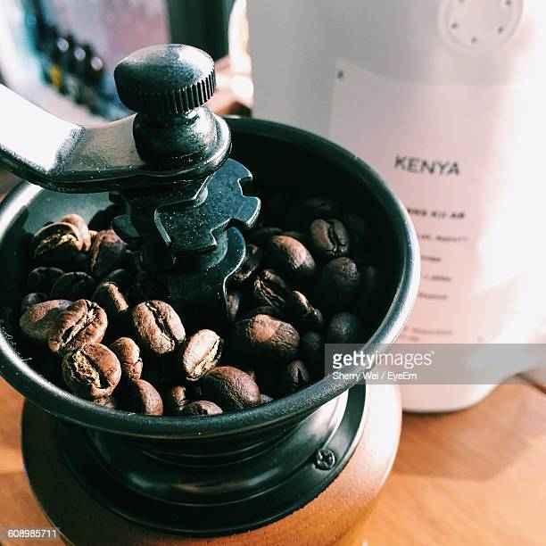 High Angle View Of Roasted Coffee Beans In Grinder On Table