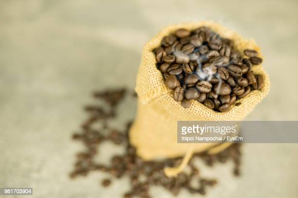 High Angle View Of Roasted Coffee Beans In Sack On Table