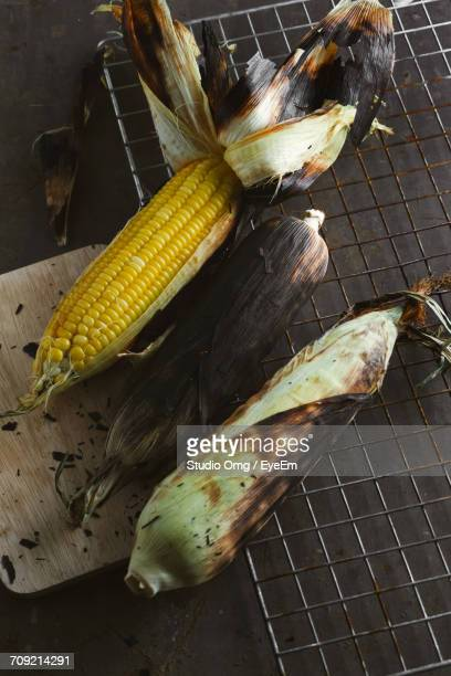 high angle view of roasted corns on cooling rack - cooling rack stock photos and pictures