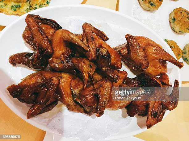High Angle View Of Roasted Pigeons In Plate