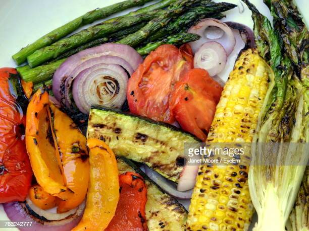 high angle view of roasted vegetables on table - roasted pepper stock photos and pictures