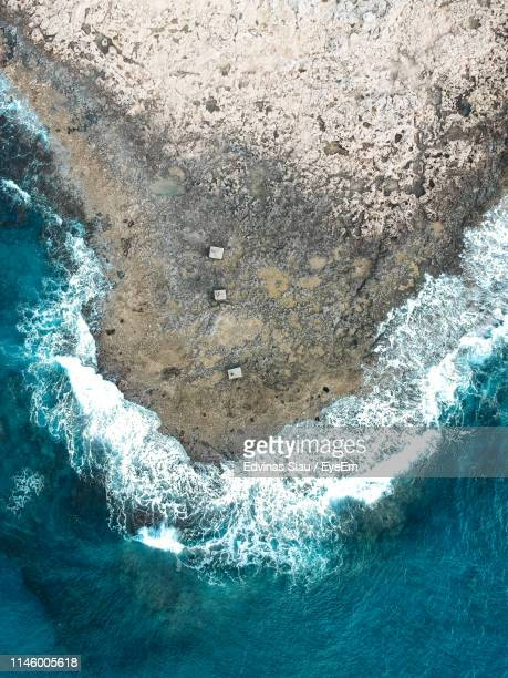 high angle view of rock formation and sea - パフォス ストックフォトと画像