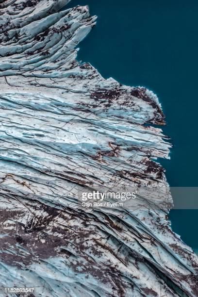 high angle view of rock formation by sea during winter - bos stock pictures, royalty-free photos & images