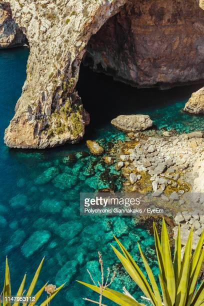 high angle view of rock formation by sea - malta stock pictures, royalty-free photos & images