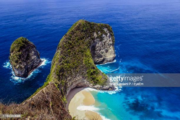 high angle view of rock formation by sea - denpasar stock pictures, royalty-free photos & images