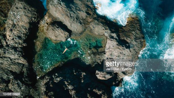 high angle view of rock formation in sea - isla de tenerife fotografías e imágenes de stock