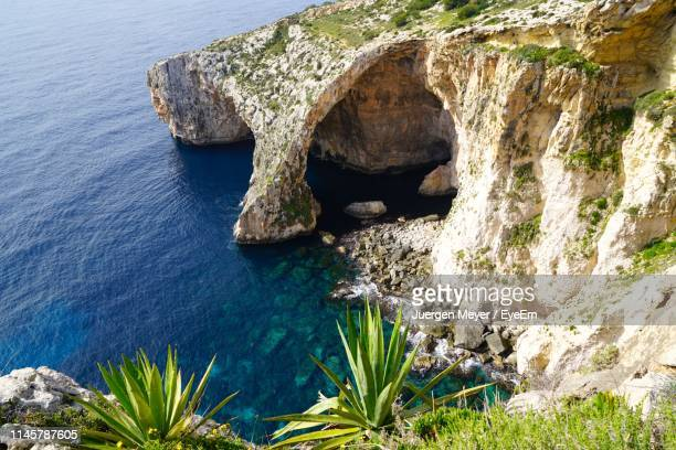 high angle view of rock formation in sea - malta stock pictures, royalty-free photos & images