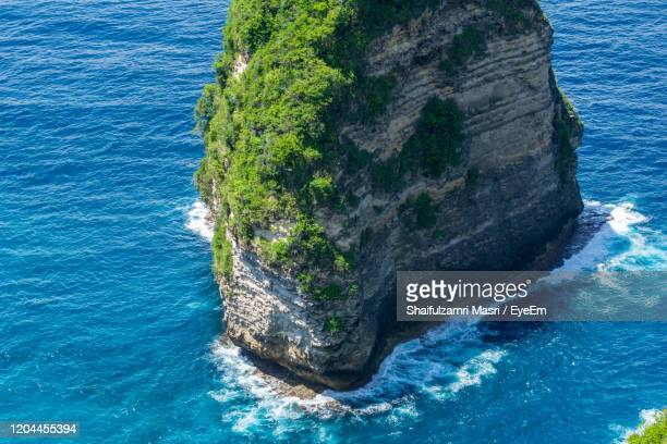 high angle view of rock formation in sea - shaifulzamri stock pictures, royalty-free photos & images