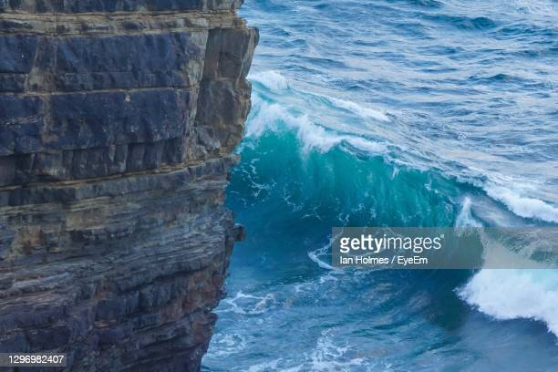 high angle view of rock formation in sea - rock stock pictures, royalty-free photos & images