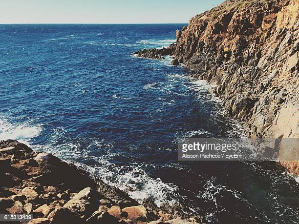 high angle view of rock formations and sea - alisson stock pictures, royalty-free photos & images