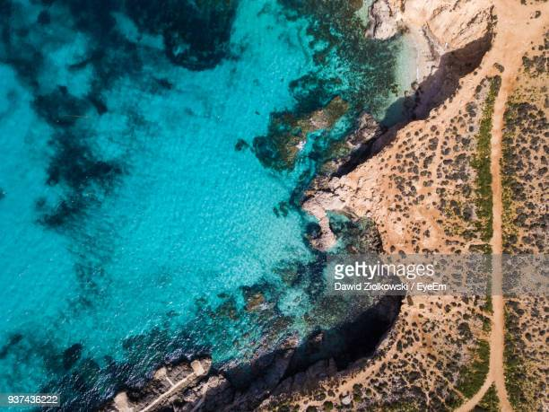 high angle view of rock formations in sea - valletta stock pictures, royalty-free photos & images