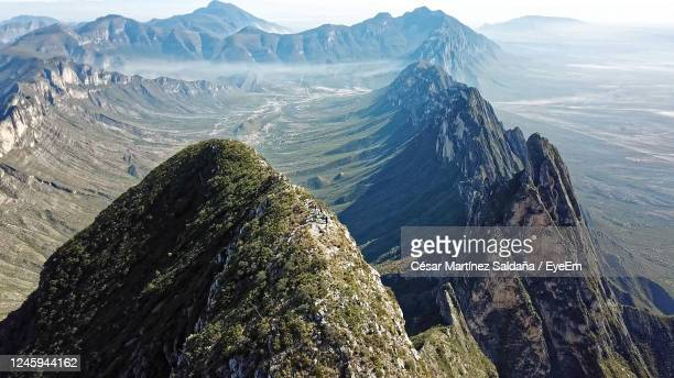 high angle view of rocks in mountains against sky - nuevo leon stock pictures, royalty-free photos & images