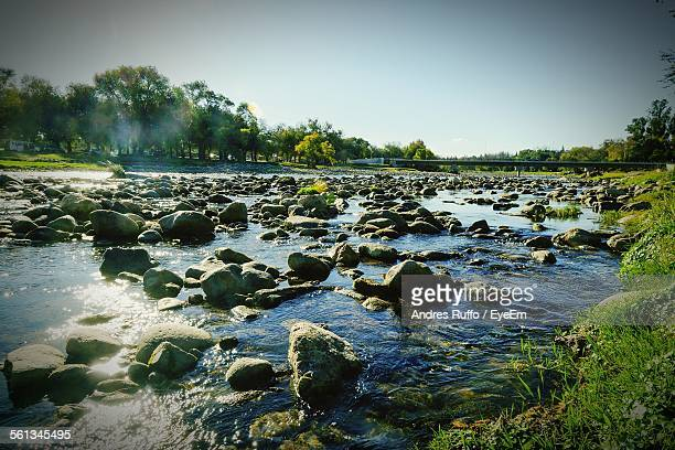high angle view of rocks in river - andres ruffo stock-fotos und bilder