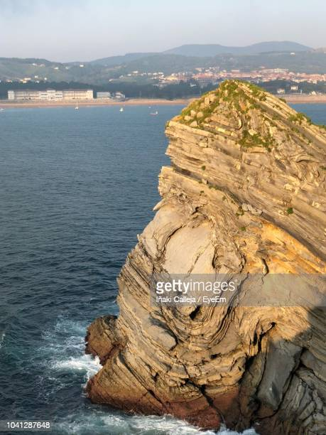 high angle view of rocks in sea against sky - iñaki mt stock photos and pictures