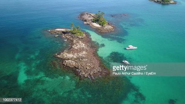 high angle view of rocks in sea - angra dos reis imagens e fotografias de stock