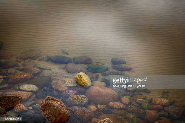 high angle view of rocks in sea - waterfront stock pictures, royalty-free photos & images