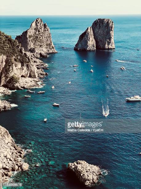 high angle view of rocks in sea - capri stock pictures, royalty-free photos & images