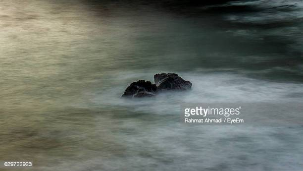 high angle view of rocks in sea - rancho palos verdes stock pictures, royalty-free photos & images