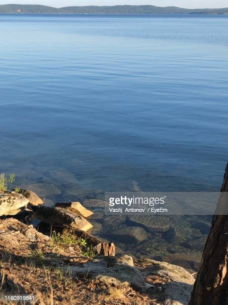 high angle view of rocks on beach against sky - antonov stock pictures, royalty-free photos & images