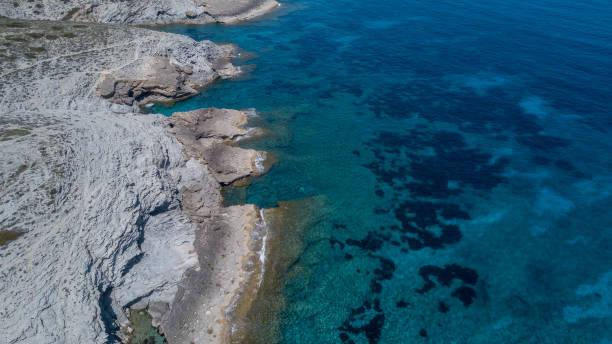 High angle view of rocks on beach, Illes Balears, Spain