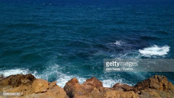 high angle view of rocks on beach - nadal stock pictures, royalty-free photos & images