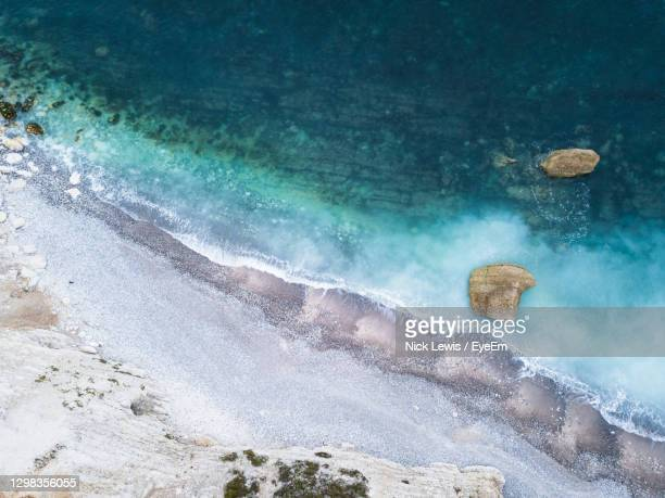 high angle view of rocks on beach - landscape scenery stock pictures, royalty-free photos & images