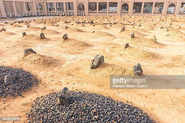 High Angle View Of Rocks On Field Against Al-Masjid An-Nabawi