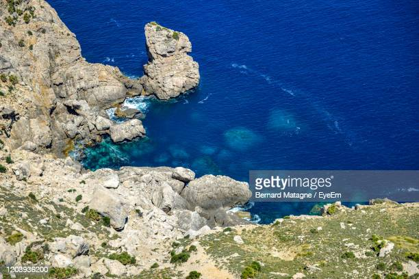 high angle view of rocks on shore - paris rocks stock pictures, royalty-free photos & images