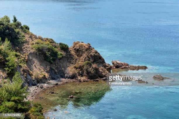 high angle view of rocky coastline in karaburun;aegean turkey. - emreturanphoto stock pictures, royalty-free photos & images