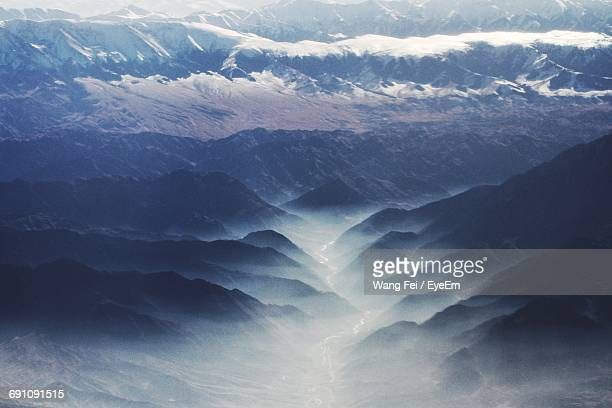 High Angle View Of Rocky Mountains During Foggy Weather
