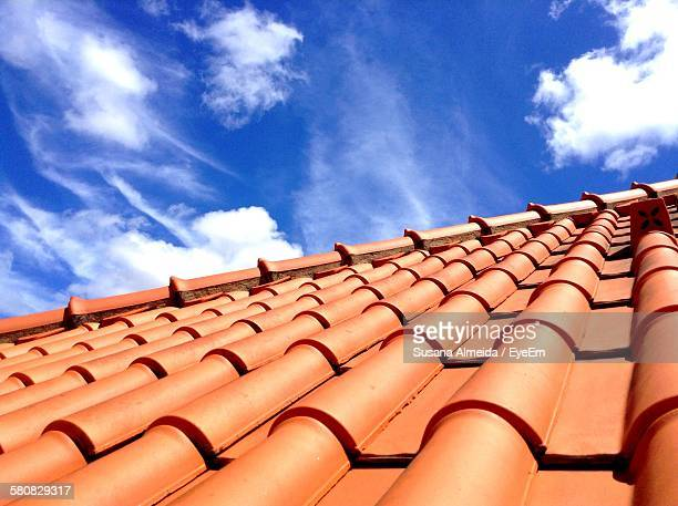 high angle view of roof tiles against sky - roof tile stock pictures, royalty-free photos & images
