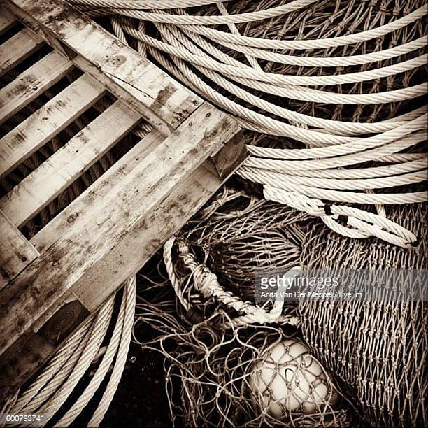 High Angle View Of Ropes And Wicker Baskets At Harbor