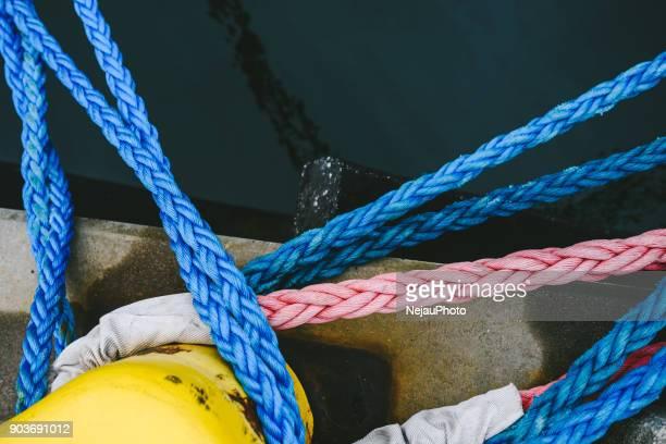 High Angle View Of Ropes Tied On Bollard At Harbor
