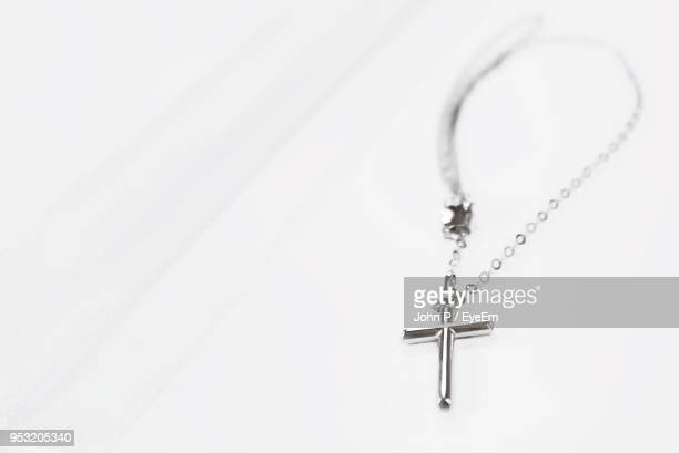 High Angle View Of Rosary On White Table