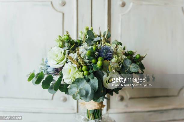 high angle view of rose bouquets against cabinet - ブーケ ストックフォトと画像
