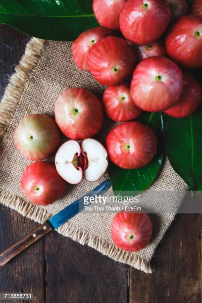 High Angle View Of Roseapples On Burlap At Wooden Table