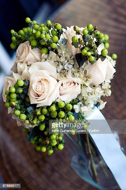 High Angle View Of Roses In Vase On Table