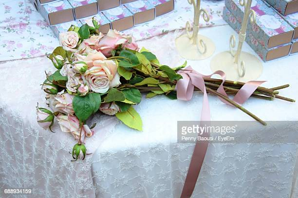 High Angle View Of Roses On Table During Wedding