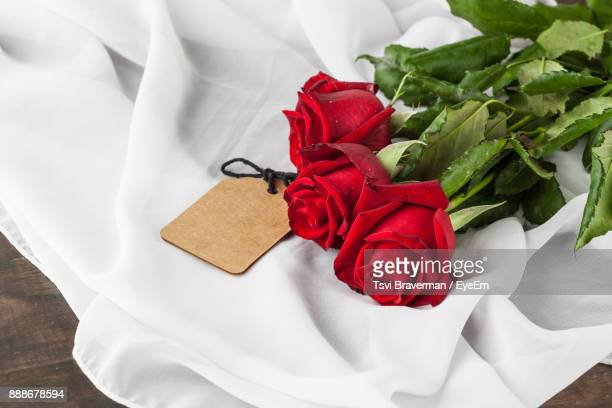 High Angle View Of Roses With Cloth On Table