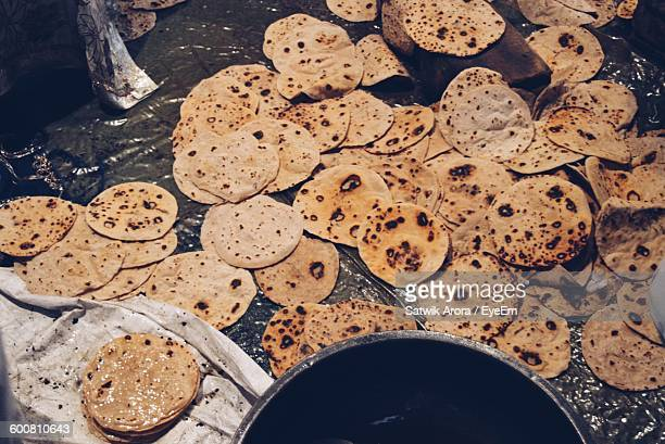 High Angle View Of Rotis On Plastic Covered Floor