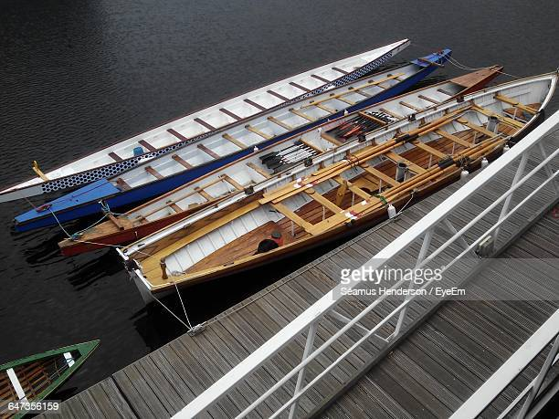 High Angle View Of Rowboats Moored By Pier In Lake