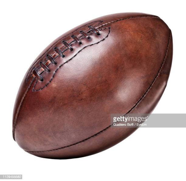 high angle view of rugby ball on white background - ラグビーボール ストックフォトと画像
