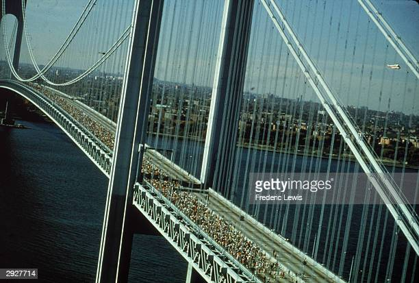 High angle view of runners in the New York City Marathon crossing the Verrazano-Narrows Bridge, circa 1978. Photo by Frederic Lewis/Getty Images)