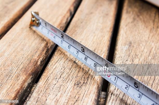 high angle view of rural tape on table - meter unit of length stock pictures, royalty-free photos & images