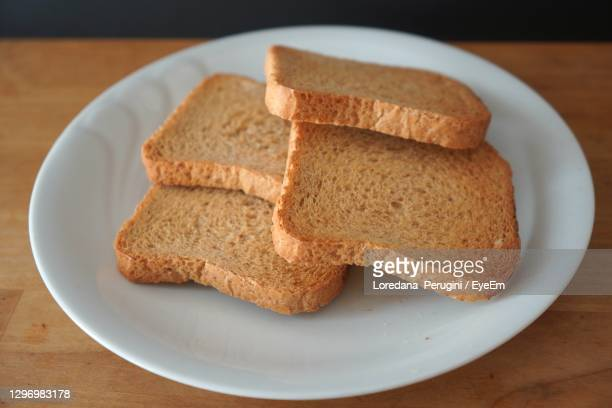 high angle view of rusks in plate on table - loredana perugini stock pictures, royalty-free photos & images