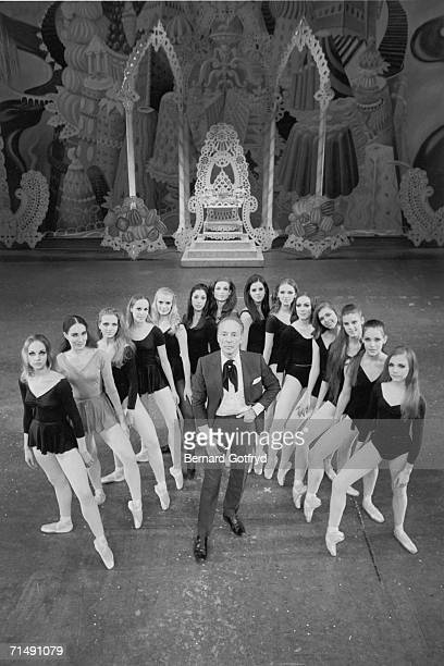 High angle view of Russianborn American ballet director and choreographer George Balanchine artistic director of the New York City Ballet who poses...