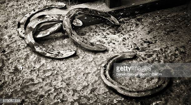 High Angle View Of Rusty Horseshoes On Field